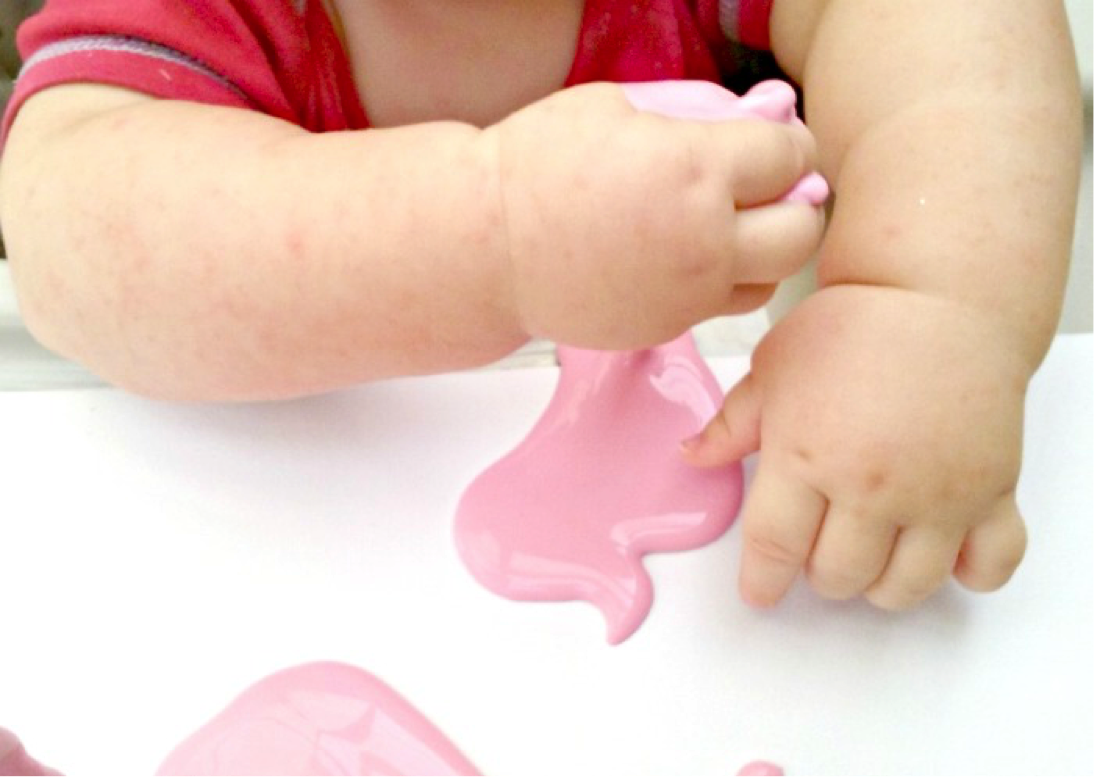 baby playing with home-made goop