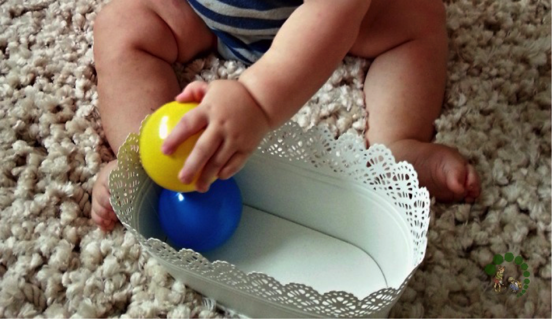 baby playing with soft balls