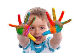 Little boy showing off his painted hands