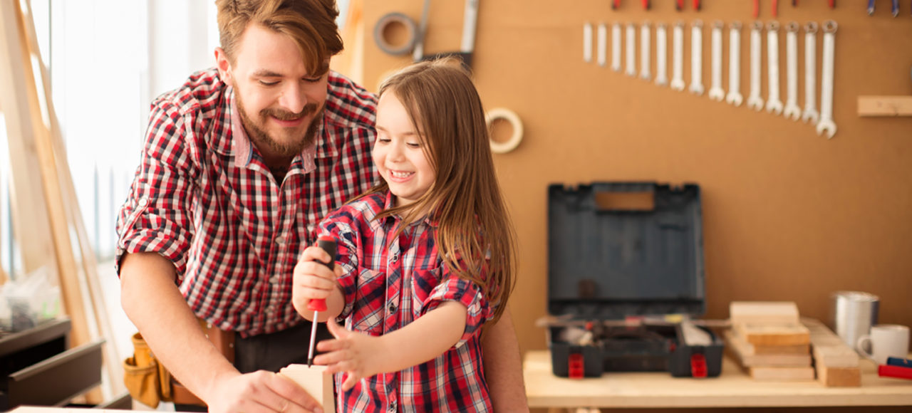 father and daughter building something together