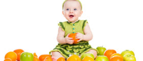 happy baby girl with fruits