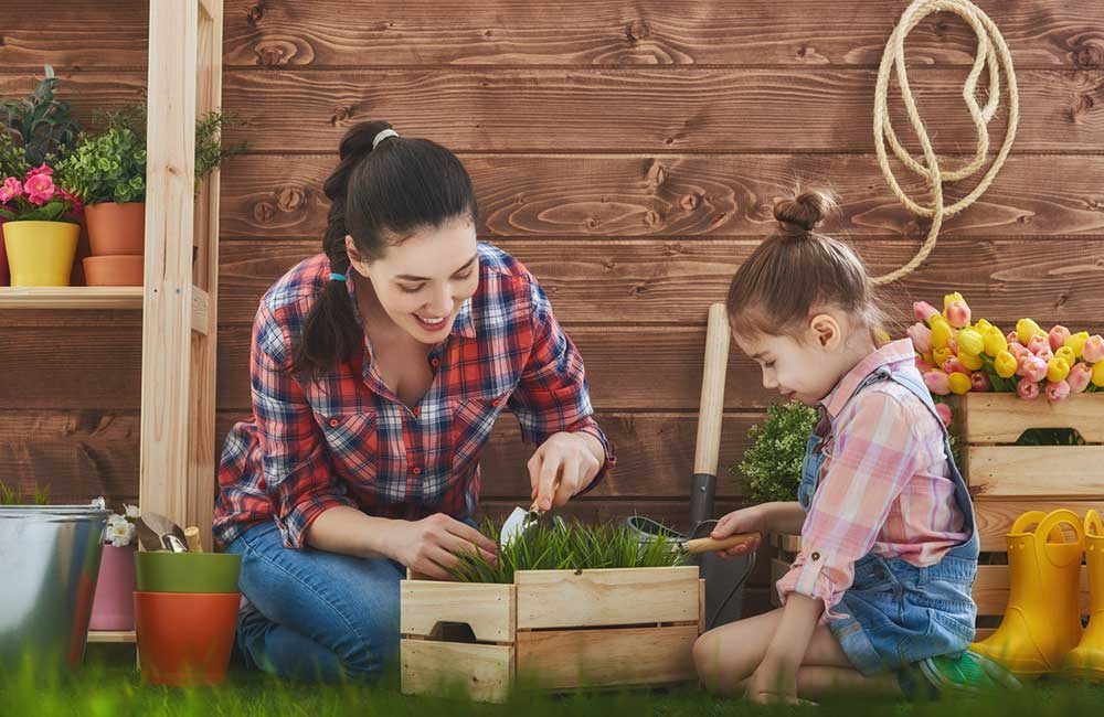 Adult gardening with child