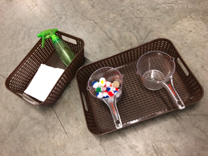 DIY craft materials - trays, water-spray bottle, and measuring cups