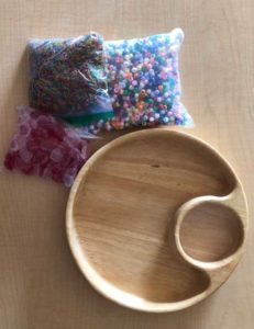 wooden tray and bagged beads