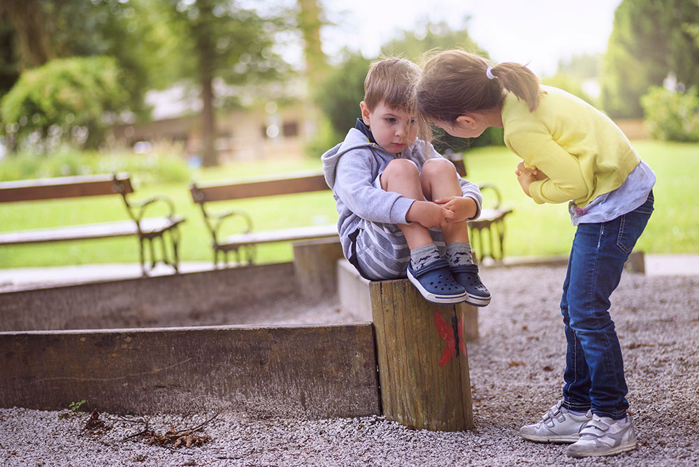 One child comforting another in the park